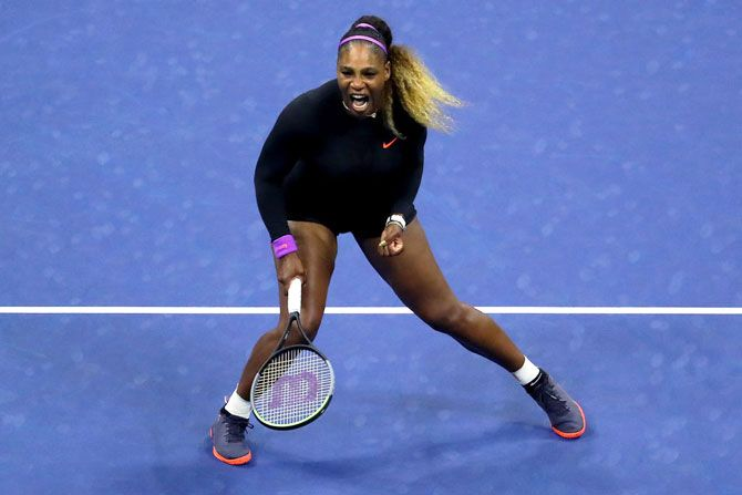 USA's Serena Williams celebrates a point during her quarter-final match against China's Qiang Wang