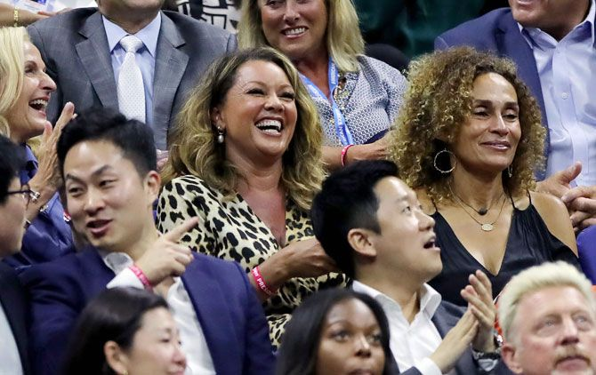Singer and actor Vanessa Williams, centre, attends the the quarter-final between Serena Williams and Qiang Wang