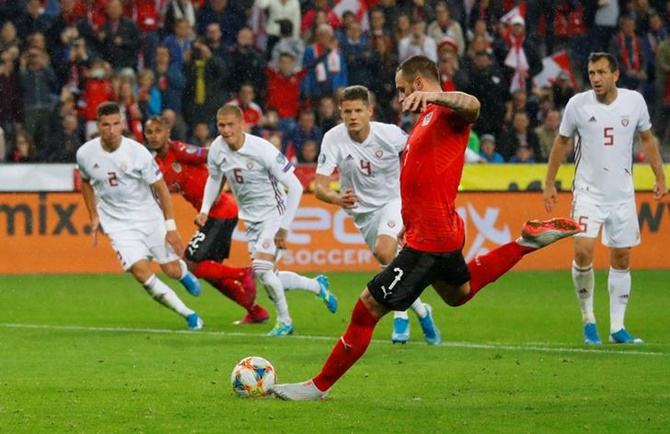 Marko Arnautovic scores Austria's third goal from the penalty spot.