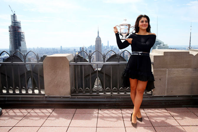 Canada's Bianca Andreescu Canada poses with the US Open trophy at the Top of the Rock at Rockefeller Center in New York City on Sunday
