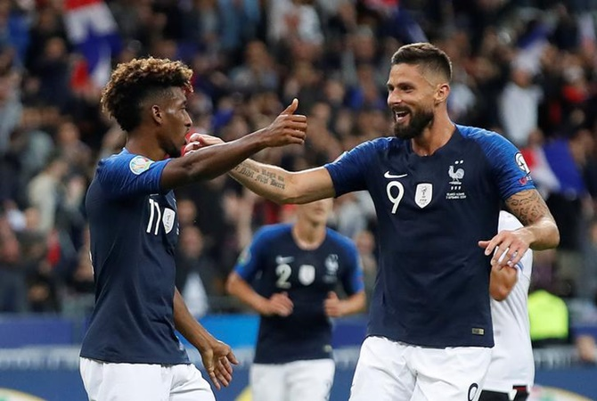 Kingsley Coman celebrates scoring France's third goal with Olivier Giroud.