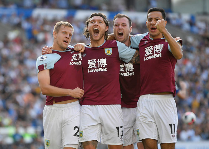 Burnley's Jeff Hendrick celebrates scoring with Matej Vydra and team mates after scoring their first goal
