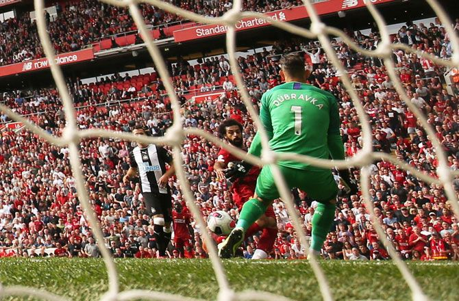 Liverpool's Mohamed Salah scores their third goal against Newcastle at Anfield on Sunday.