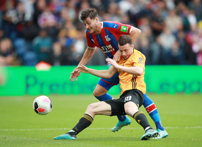 Wolverhampton Wanderers' Diogo Jota in action with Crystal Palace's Joel Ward during their match at Selhurst Park in London