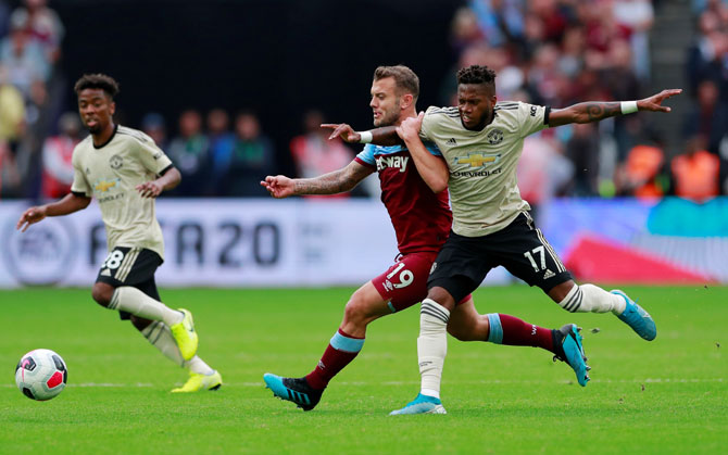 West Ham United's Jack Wilshere and Manchester United's Fred vie for possession