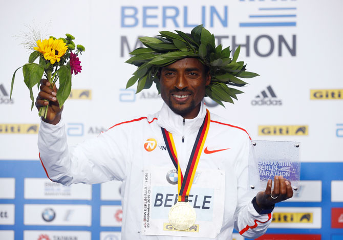 Ethiopia's Kenenisa Bekele celebrates on the podium after winning the men's elite race at the Berlin Marathon in Berlin on Sunday