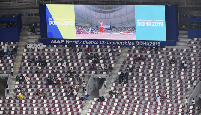 Empty seats are seen in the stands at Khalifa International Stadium on Day 4 of 17th IAAF World Athletics Championships in Doha, Qatar on Monday
