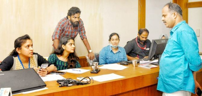 CK Vineeth at a meeting in the government helpline centre