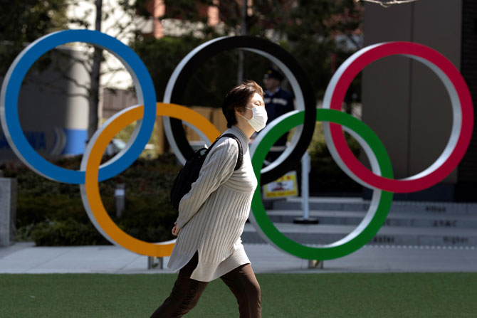 Fans at Olympics will need negative COVID tests?