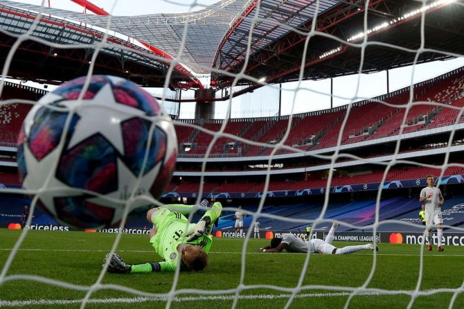 The ball hits the back of the net as FC Bayern Munich's David Alaba scores an own goal past keeper Manuel Neuer to help register FC Barcelona's first goal