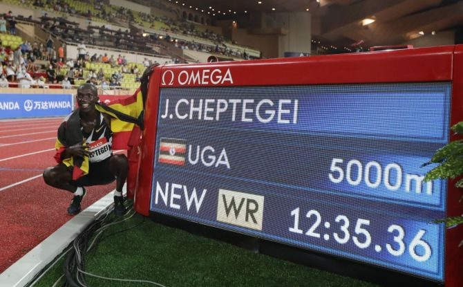 Uganda's Joshua Cheptegei celebrates after winning the men's 5000m and setting a new world record at the Diamond League at Stade Louis II, Monaco, on August 14, 2020