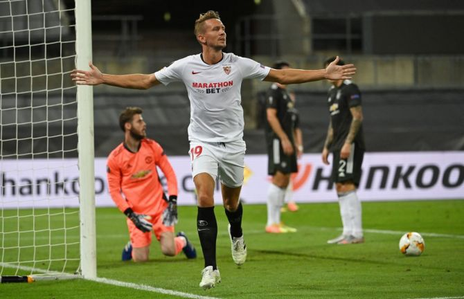 Sevilla's Luuk de Jong celebrates scoring their second goal against Manchester United at RheinEnergieSTADION in Cologne, Germany
