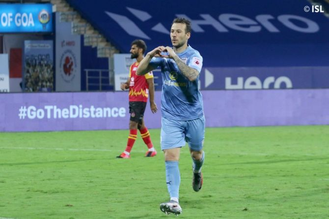 Mumbai City FC's Adam Le Fondre celebrates on scoring from the spot against SC East Bengal during their ISL match at Bambolim, Goa, on Tuesday