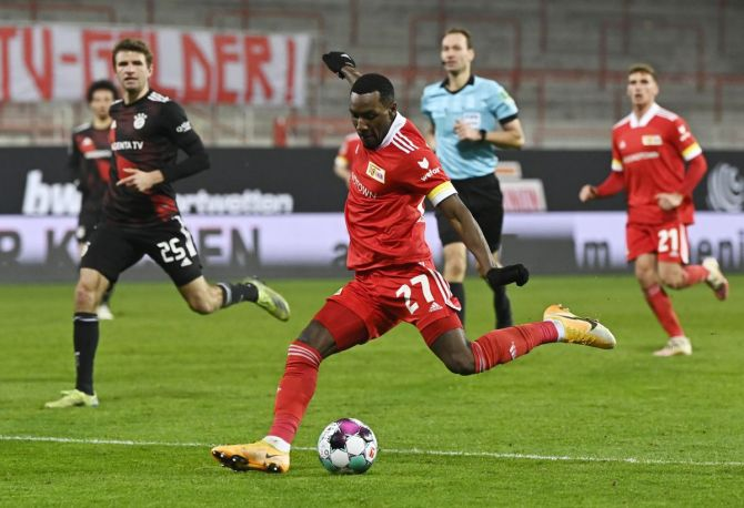 FC Union Berlin's Sheraldo Becker shoots at goal during their match against Bayern Munich at Stadion An der Alten Forsterei, Berlin, on Saturday