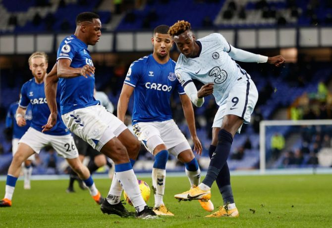 Chelsea's Tammy Abraham in a battle for the ball with Everton players during their match at Goodison Park in Liverpool