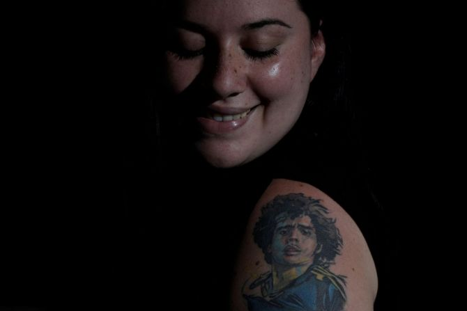 "Nerea Barbosa poses for a photo at her home in Buenos Aires.  ""It is love, it is my great love, my passion to have Diego (on my body) so he is always with me everywhere. I feel like he protects me,"" said Barbosa."