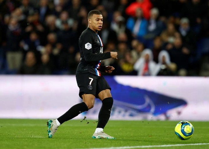 Kylian Mbappe scores Paris St Germain's fourth goal against Montpellier in Saturday's Ligue 1 match