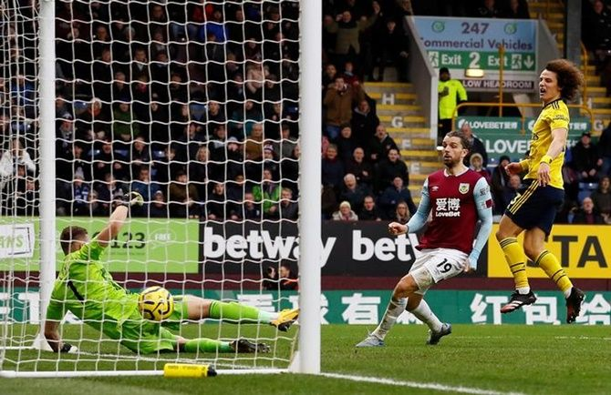 Burnley's Jay Rodriguez watches the ball bounce on the goal line after shooting against the crossbar.