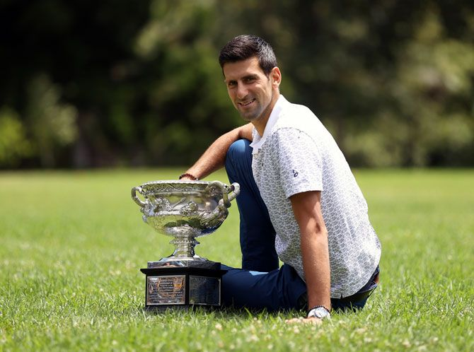 Novak Djokovic poses during the 2020 Australian Open Men's Trophy. The Australian Open, which started in January, has so far been the only Grand Slam that was not impacted in 2020 with the French Open organisers moving the claycourt major back to September from its May start.