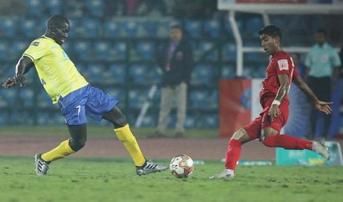 Kerala Blaster's Mouhamadou Gning tries to make his way past the NorthEast United defence