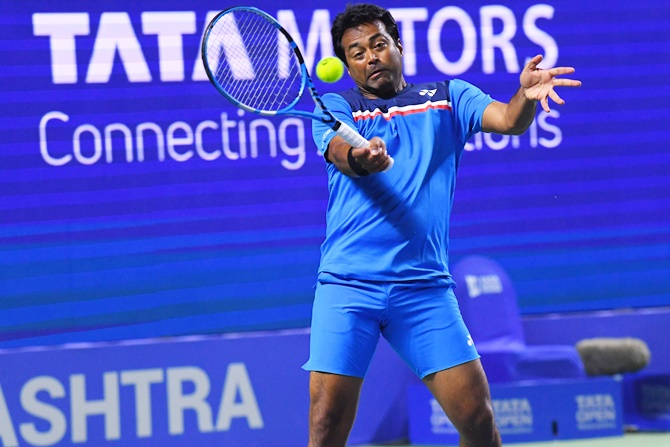Leander Paes in action against Ramkumar Ramanathan and Purav Raja in the doubles quarter-final at the Tata Open Maharashtra, in Pune on Thursday
