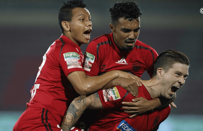 NorthEast United players celebrate after Federico Gallego puts them ahead in Monday's ISL match against Jamshedpur.
