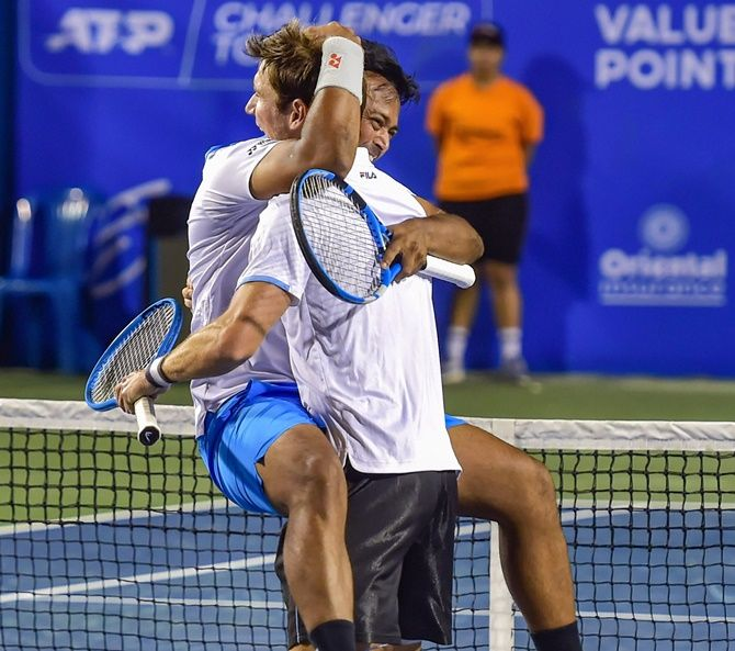 Leander Paes and Australia's Matthew Abden celebrate after making the doubles semi-finals at the Bengaluru Open on Thursday