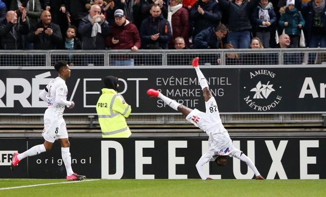 Fousseni Diabate celebrates scoring Amiens's third goal.