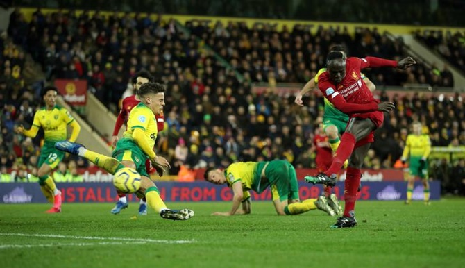 Sadio Mane essays from the top of the box to score for Liverpool in their Premier League match against Norwich City on Saturday.