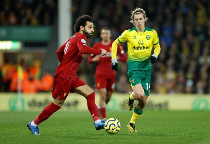 Liverpool's Mohamed Salah makes his way past Norwich City's Todd Cantwell.