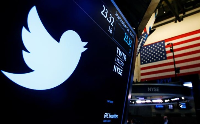 The Twitter logo is displayed on a screen on the floor of the New York Stock Exchange (NYSE) in New York City.