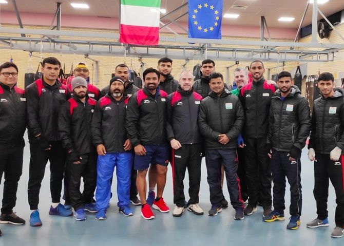 India's boxing team pose for a picture ahead of a training session in Assisi.