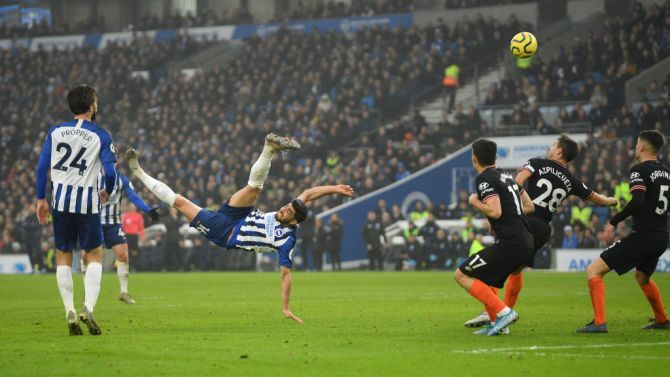 Brighton & Hove Albion's Alireza Jahanbakhsh scores with a spectacular overhead kick against Chelsea FC at American Express Community Stadium in Brighton