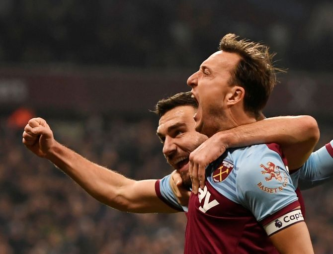 West Ham United's Mark Noble celebrates scoring their first goal against AFC Bournemouth at London Stadium in London