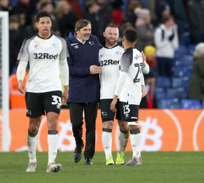 Phillip Cocu, Manager of Derby County celebrates with Wayne Rooney following their win in the FA Cup third round match against Crystal Palace at Selhurst Park in London on Sunday