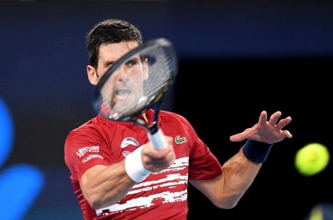 Serbia's Novak Djokovic plays a forehand return during his win over France's Gael Monfils on day four of the 2020 ATP Cup Group Stage match at Pat Rafter Arena in Brisbane on Monday