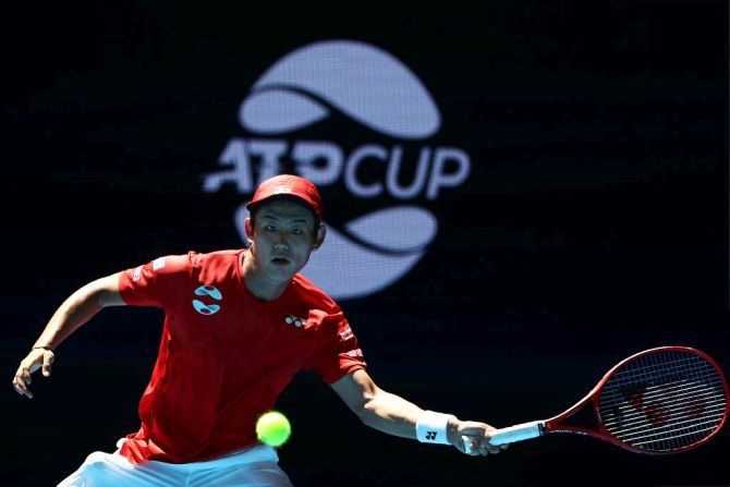 Team Japan's Yoshihito Nishioka in action against Team Georgia's Nikoloz Basilashvili during day four of the 2019 ATP Cup Group Stage at RAC Arena in Perth on Monday