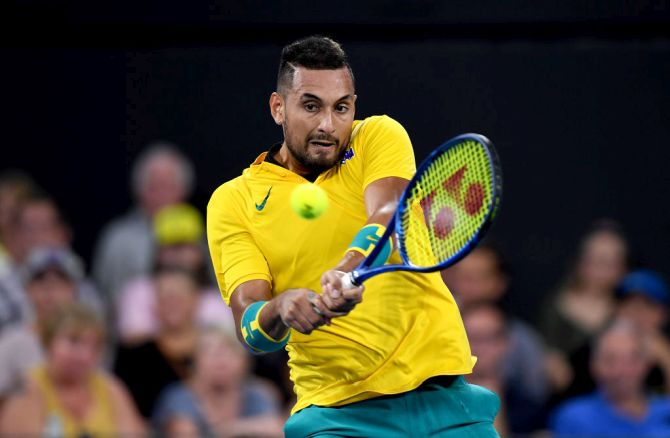 Australia's Nick Kyrgios plays a backhand return against Greece's Stefanos Tsitsipas during day five of the ATP Cup Group Stage at Pat Rafter Arena in Brisbane on Tuesday
