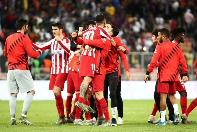 Atletico Madrid's Angel Correa celebrates with teammates after win over Barcelona to reach the Super Cup final at King Abdullah Sports City in Jeddah, Saudi Arabia, on Thursday
