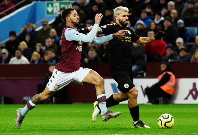 Manchester City's Sergio Aguero in action with Aston Villa's Douglas Luiz during their English Premier League match on Sunda