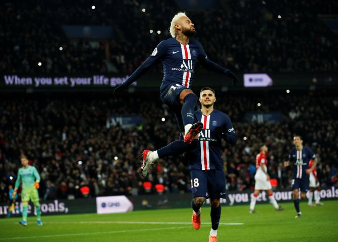 Paris St Germain's Neymar celebrates after scoring their third goal from the penalty spot during their Ligue 1 match against AS Monaco at Parc des Princes in Paris on Sunday