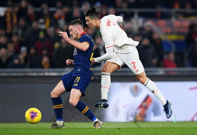 Juventus' Cristiano Ronaldo vies with AS Roma's Jordan Veretout during their Serie A match at Stadio Olimpico, Rome, Italy on Sunday