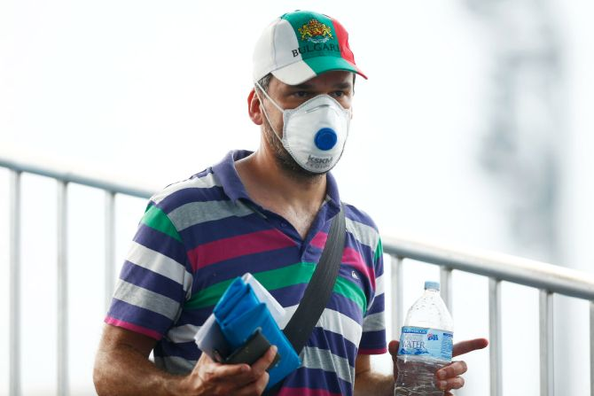 A fan wears a respiratory mask during 2020 Australian Open Qualifying at Melbourne Park in Melbourne on Tuesday