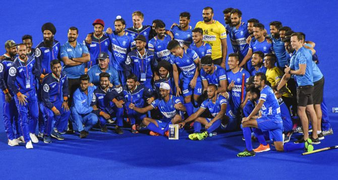 A jubilant Indian team pose for pictures after their victory over Netherlands in the FIH Pro League (Men) 2020 hockey match at Kalinga Stadium in Bhubaneswar on Sunday
