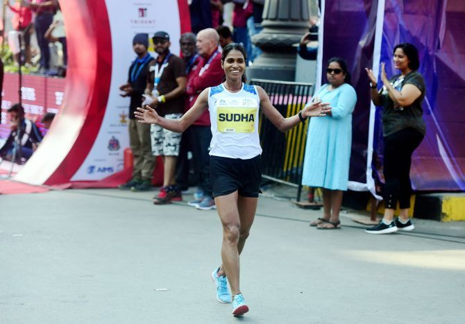India's elite athlete Sudha Singh celebrates on crossing the finish line to win the gold medal in the Tata Mumbai Marathon 2020 (elite class), in Mumbai, Sunday
