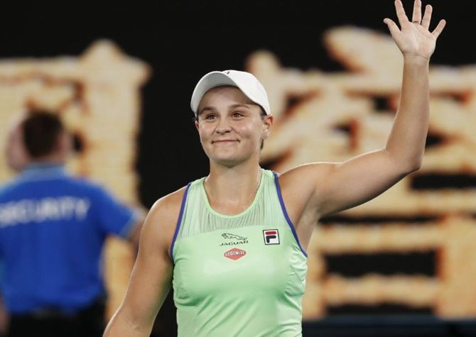 Australia's Ashleigh Barty celebrates after winning her first round match against Ukraine's Lesia Tsurenko at the Australian Open in Melbourne on Monday