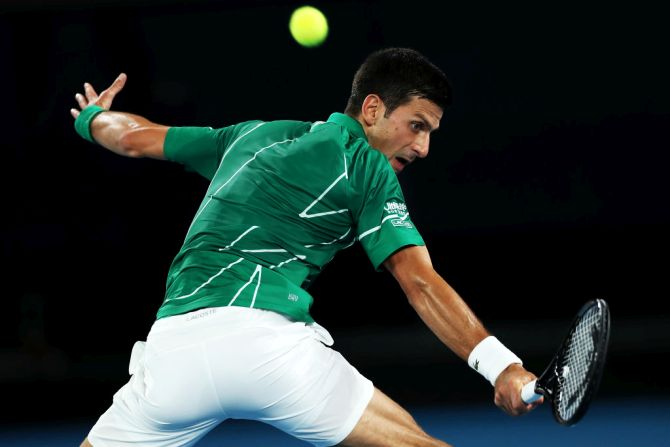 Serbia's Novak Djokovic plays a backhand during his first round match against Germany's Jan-Lennard Struff