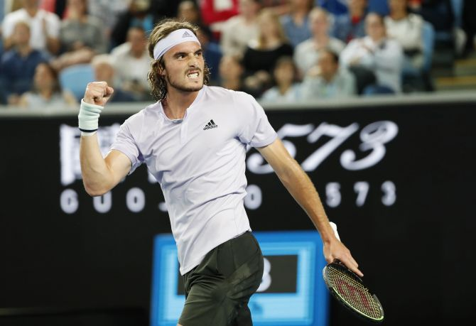 Greece's Stefanos Tsitsipas celebrates after defeating Italy's Salvatore Caruso