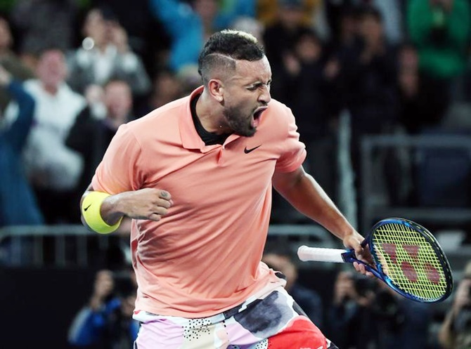 Australia's Nick Kyrgios celebrates victory over France's Gilles Simon in the second round
