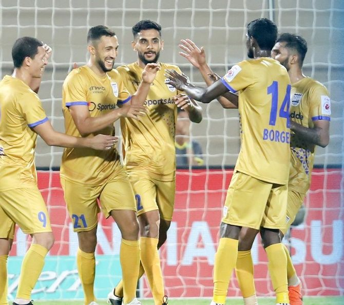 Mumbai FC players congratulate Mohamed Larbi as they celebrate his goal during the ISL match against Hyderabad on Friday